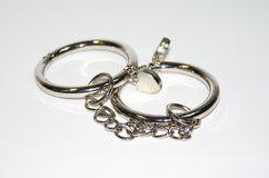 Metal handcuffs  on the white background Royalty Free Stock Photography
