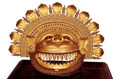 Metal handicraft sun god mask Royalty Free Stock Image