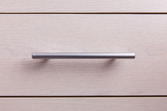 Metal handle on the furniture Royalty Free Stock Photos