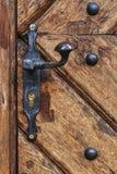 Metal handle. An old wood door with metal handle Royalty Free Stock Photo