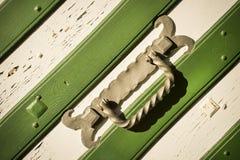 Metal handle on white green gate Royalty Free Stock Photo