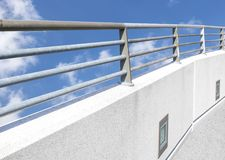 Handrail on wall. Metal handrail on concrete wall Royalty Free Stock Photos