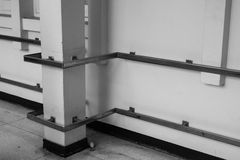 Metal handrail on hospital corridor. Metal handrail on white wall on hospital corridor Royalty Free Stock Images