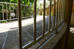 Metal handrail of slope pedestrian walkway Royalty Free Stock Photo