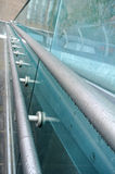 Metal handrail. The wet metal and glass handrail Royalty Free Stock Photography