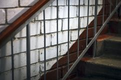 Metal Handrails, Concrete Stairs, White Brick Wall.  stock images
