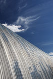 Metal hangar roof against the blue sky Stock Image