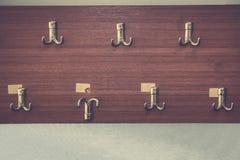 Metal hangers on wall stock photo