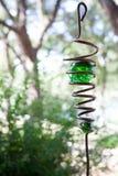 Metal hanging yard ornament. /art with green glass globe stock image