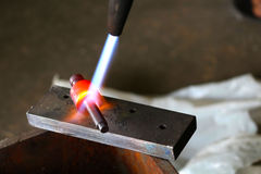 Metal hardening with gas cutting torch Royalty Free Stock Photos