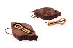 Metal harp and a carved wooden box. Metal harp and carved brown wooden box Royalty Free Stock Photography