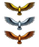 Metal Hawks. Golden, silver and bronze hawk figures, set of metal birds Royalty Free Stock Images