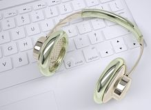 Metal headphones on the keyboard Royalty Free Stock Photos
