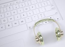Metal headphones on the keyboard Stock Photos