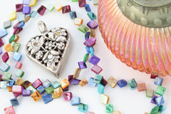Metal Heart. With colorful necklace on a white background Stock Images