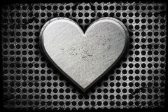 Metal heart. On a metal background stock photos
