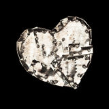 Metal heart. Dark rusty metal armored heart against a black background royalty free stock photo