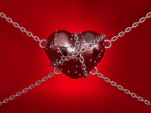 Metal heart. Hang up on chains, on red background Stock Image