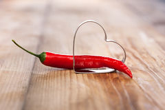 Metal heart with chili pepper Stock Photo