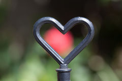 Metal heart in cottage garden Royalty Free Stock Photo