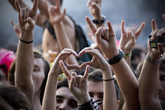 Metal Heart. Crowd during a concert, a heart in the middle of metal horns Stock Photo