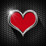 Metal Heart on a Dark Grid Stock Photos