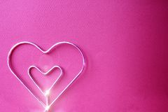 Metal heart with fucsia background Stock Photography