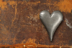 Metal heart on grunge background Royalty Free Stock Photos