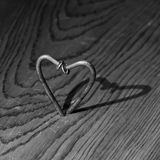 Metal heart. Grunge foto of two nails forming a shape of heart Royalty Free Stock Image