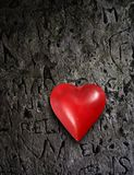 Metal heart on grunge wall Royalty Free Stock Image