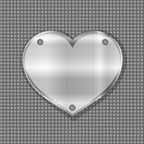 Metal heart label on steel background Stock Photo