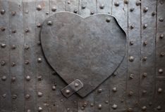 Metal heart. Old metal heart as a metaphor royalty free stock images
