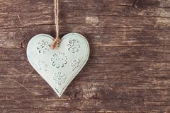 Metal heart. On the old wooden background royalty free stock photography