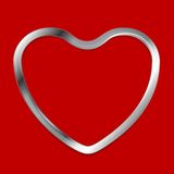 Metal heart on red background Royalty Free Stock Photography