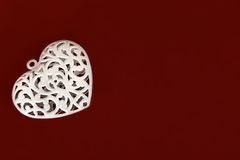 Metal heart on red background Stock Image