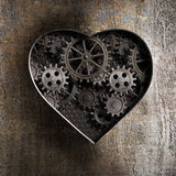 Metal heart with rusty gears. And cogs stock photo