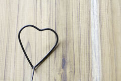 Metal heart shape on wood Background Royalty Free Stock Image