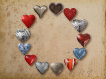 Metal heart shaped things arranged in circle Stock Photos