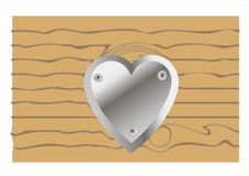 Metal heart on wooden background. Metal heart screwed vitamin tree Stock Photography