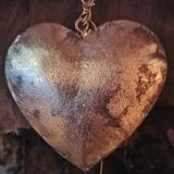 Metal heart. Wooden wire gold stock photos