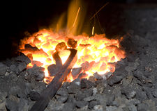 Metal in the hearth. Detail from smithy stock photos