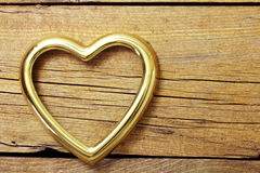 Metal hearts in old wooden background Royalty Free Stock Image