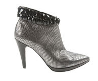 Metal heels ankle boot with crystals. Silver metal heel ankle boot with crystals isolated on white background. Clipping path included Royalty Free Stock Images