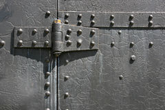 Metal hinge. Industrial steel tin door texture. Metal hinge and bolts royalty free stock image