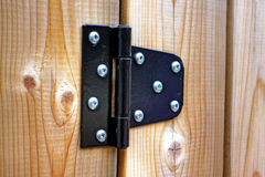 Metal hinge on wood stock photography