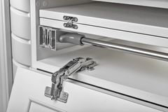 Metal hinges for a cupboard. Close Up stock photo