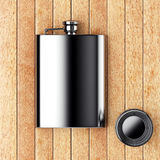 Metal hip flask with cup Stock Photo