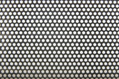 Metal with holes background Stock Photo