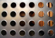 Metal holes urban detail Stock Photo