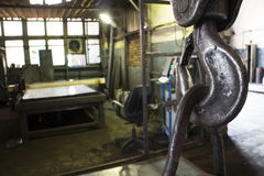 Metal hook on the background of the workshop. In production hall Stock Image